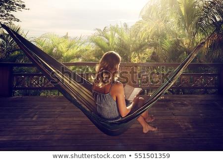 bruna · rilassante · amaca · spiaggia · donna · felice - foto d'archivio © andreypopov