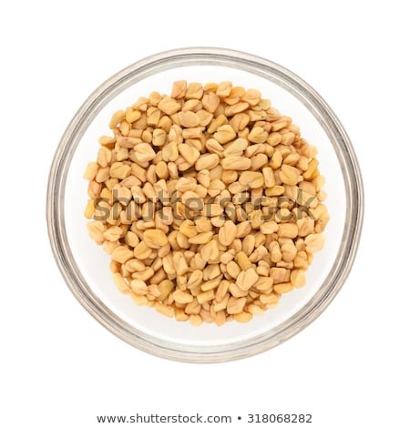 Top view of half filled bowl of Organic Fenugreek. Stock photo © ziprashantzi