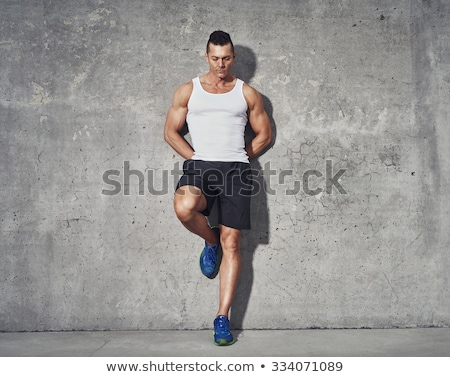 Muscular Man Wearing Gray Athletic Shorts Stock photo © stryjek