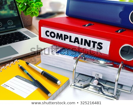 Complaints on Red Ring Binder. Blurred, Toned Image. Stock photo © tashatuvango