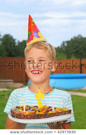 boy with fruit pie, happy birthday party seven years Stock photo © Paha_L