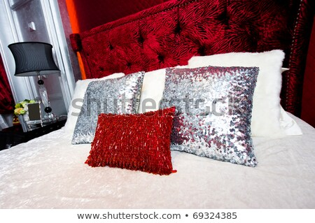 Cozy bedroom with red and white details stock photo © jrstock