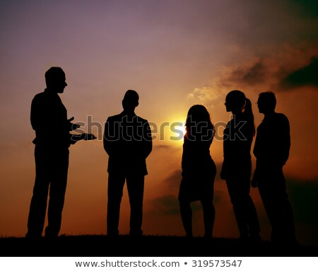 Business people with leader silhouette on sky Stock photo © Paha_L