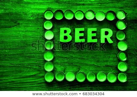 beer bottle caps frame over wooden background stock photo © stevanovicigor