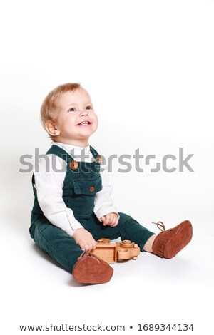 мало мальчика сидят изолированный белый технологий Сток-фото © DedMorozz