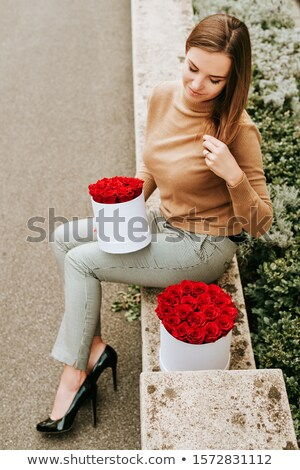 Beautiful young woman sitting in a trendy shoes Stock photo © artfotodima