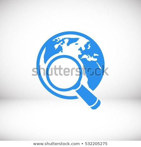 globe and magnifying glass stock photo © devon