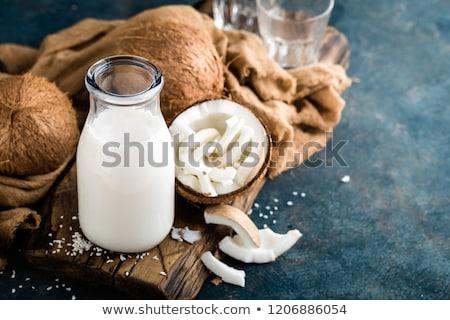 Fresco leite de coco vidro coco concha velho Foto stock © Lana_M