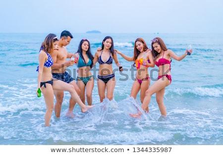 seksi · kadın · plaj · bulutlar · arka · plan · yaz - stok fotoğraf © kakigori