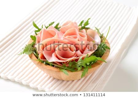 sliced ham with arugula leaves stock photo © digifoodstock