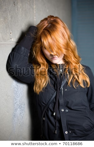 Lonely and sad, moody portrait of a beautiful fashoinable young  Stock photo © lithian