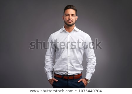 attractive thoughtful young man in white shirt looking stock photo © deandrobot