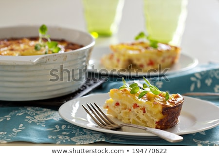 Potato breakfast gratin with parmesan Stock photo © yelenayemchuk