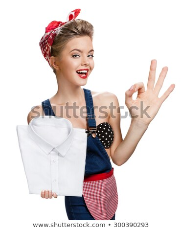 Cheerful young lady showing okay gesture. Stock photo © deandrobot