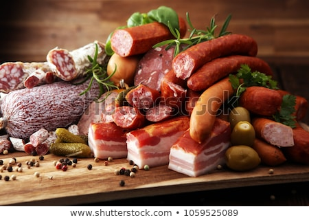 Salad with slices of smoked meat and vegetables on a white plate Stock photo © Yatsenko
