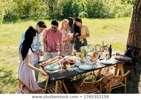 Young Children At Party With Mothers Sitting At Table With Food Stock photo © Pressmaster