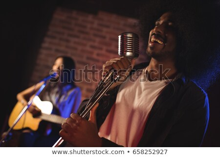 Cheeful female singer with male guitarist performing at nightclub Stock photo © wavebreak_media