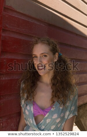 portrait of happy women standing against beach huts stock photo © wavebreak_media