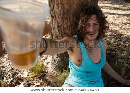 Unconscious man having beer in the park Stock photo © wavebreak_media