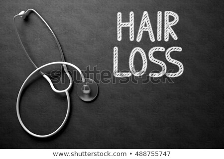 Hair Loss Handwritten on Chalkboard. 3D Illustration. Stock photo © tashatuvango