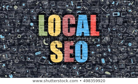 multicolor local seo on dark brickwall doodle style stock photo © tashatuvango