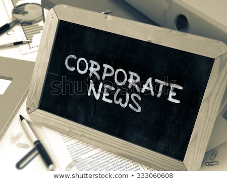 corporate news on binder toned image stock photo © tashatuvango