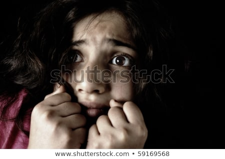 low key shot of a scared and filthy brown haired child stock photo © zurijeta