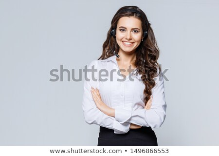 Jeunes brunette dame gris robe posant Photo stock © arturkurjan