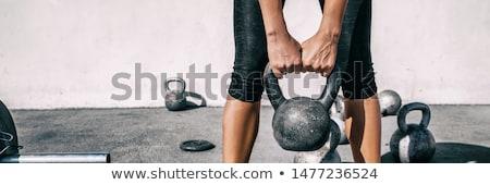Bodybuilder lifting heavy kettlebell Stock photo © wavebreak_media