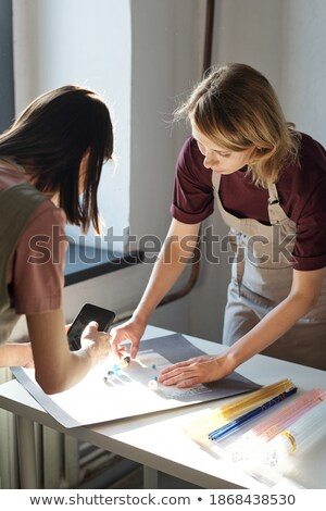 Businesswomen working with glass beads Stock photo © IS2
