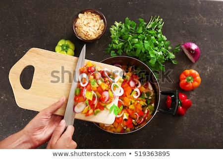 Woman chopping peppers on chopping board Stock photo © IS2