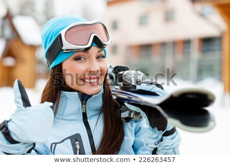 Girl holding skis Stock photo © IS2