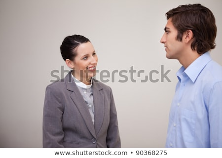 A woman talking to a man in a hallway Stock photo © IS2