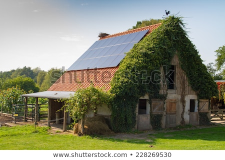 a solar collector on a roof of old house stock photo © simazoran