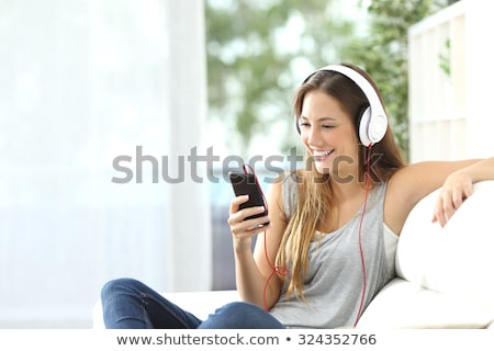 Portrait of a smiling young girl student in earphones Stock photo © deandrobot