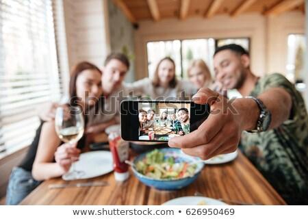 Friends eating snack taking selfie on smartphone Stock photo © jossdiim