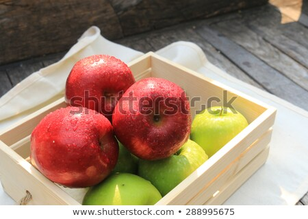 apples freshly picked from the garden   on the wooden table with stock photo © lightkeeper