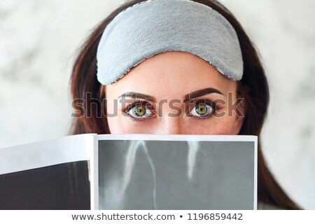 Portrair of the brunette woman reading a magazine  Stock photo © dashapetrenko