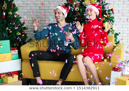 Christmas tree, holiday gifts and colorful confetti in the air Stock photo © ussr
