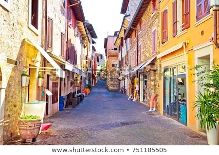 Lago di Garda town of Sirmione colorful street view Stock photo © xbrchx