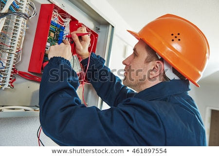 technician repairing fuse box with screwdriver stock photo © andreypopov