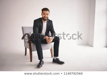 Portret przystojny biznesmen formalny garnitur posiedzenia Zdjęcia stock © deandrobot