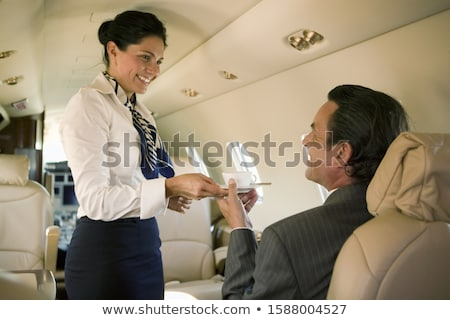 Flight attendant serving drinks Stock photo © colematt