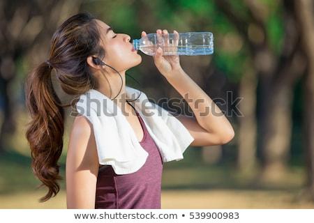 Frau Trinkwasser Strand Fitness Sport Stock foto © dolgachov