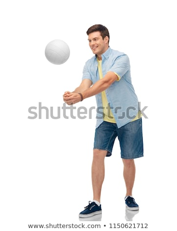 Souriant jeune homme jouer volleyball sport loisirs Photo stock © dolgachov