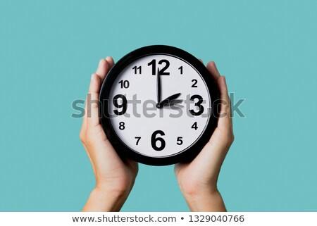 Saat geri ileri eller genç Stok fotoğraf © nito