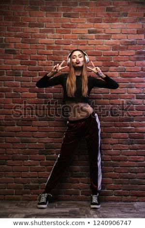 изображение · кавказский · женщину · спортивная · одежда · наушники - Сток-фото © deandrobot