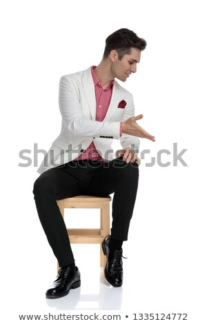 seated young businessman presenting something down  Stock photo © feedough