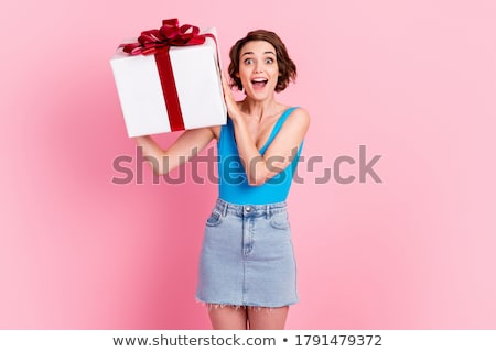 Charming happy girl with red boxes with red bow. Stock photo © studiolucky