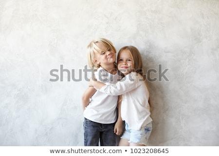 Twee kaukasisch broers en zussen broer zus poseren Stockfoto © Lopolo